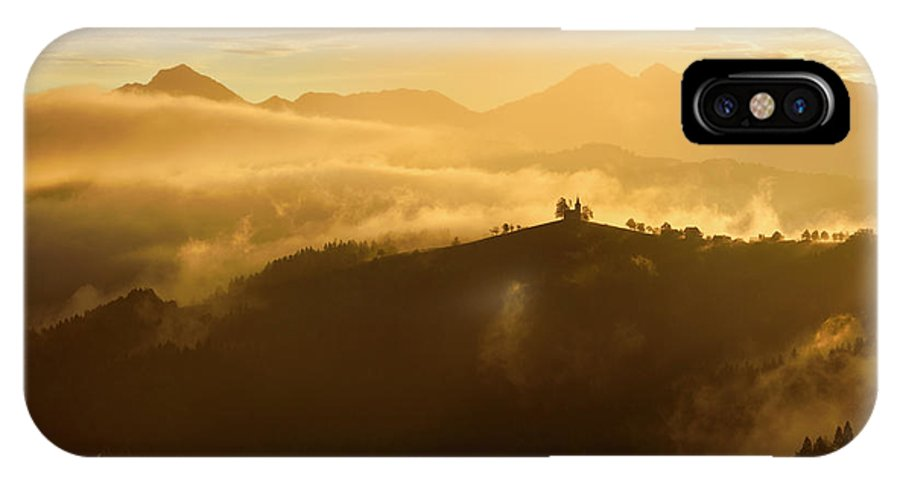 Golden IPhone X Case featuring the photograph Golden Clouds And Fog At Sunrise In The Mountains Of Kamnik Savi by Reimar Gaertner