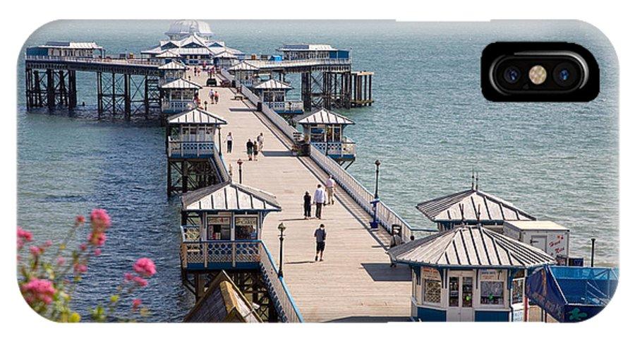 Llandudno IPhone X Case featuring the photograph Llandudno Pier North Wales Uk by Mal Bray