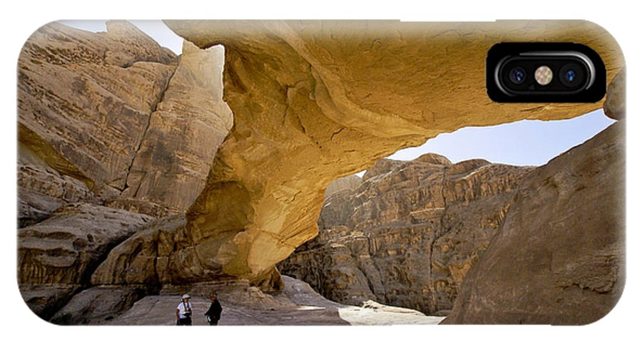 Middle East IPhone X Case featuring the photograph Natural Arch In Wadi Rum by Michele Burgess