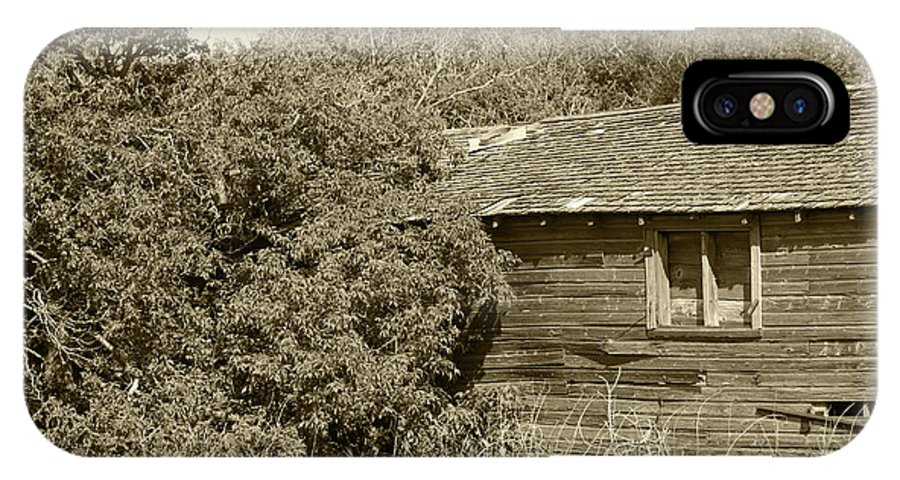 Barn IPhone X Case featuring the photograph Old Abandoned Barn Falling To Ruin by Robert Hamm