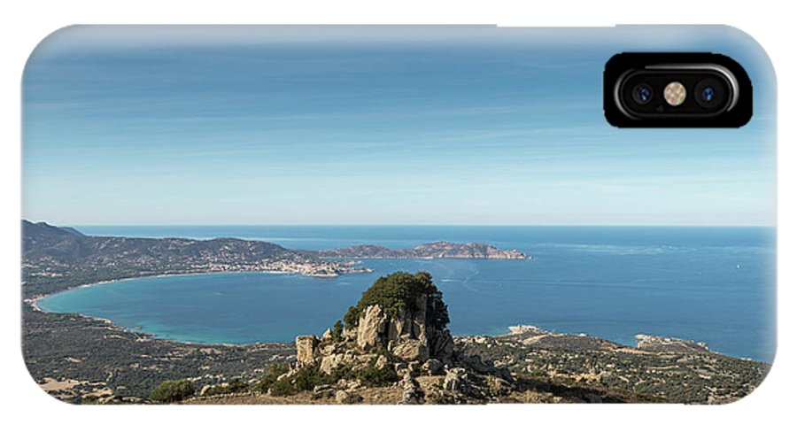 Balagne IPhone X Case featuring the photograph Rocky Outcrop Above Calvi Bay In Corsica by Jon Ingall