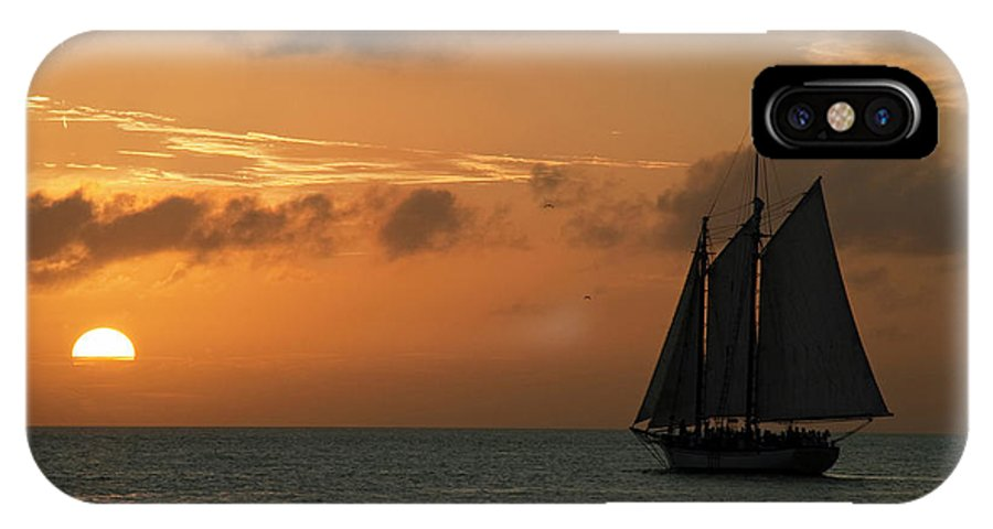 Sail IPhone X / XS Case featuring the photograph Sailing Into The Sunset by Robert Shard