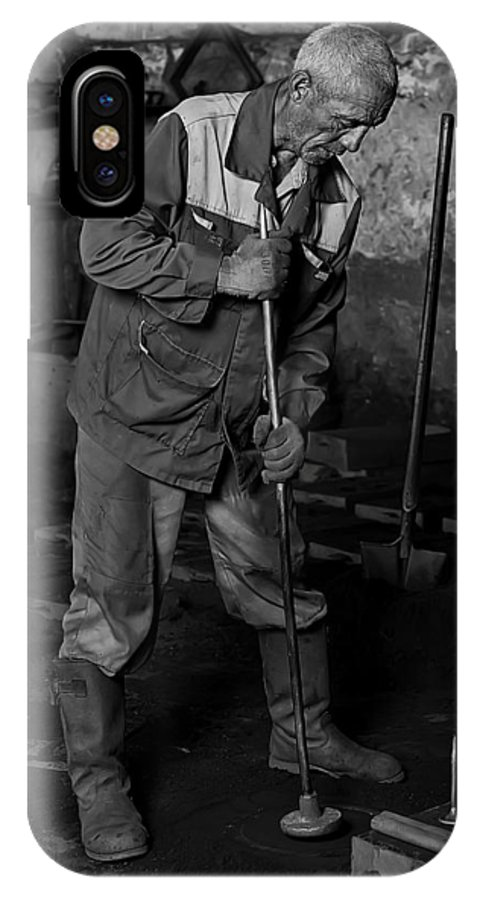 Worker IPhone X Case featuring the photograph Worker In The Foundry by Marat Jolon