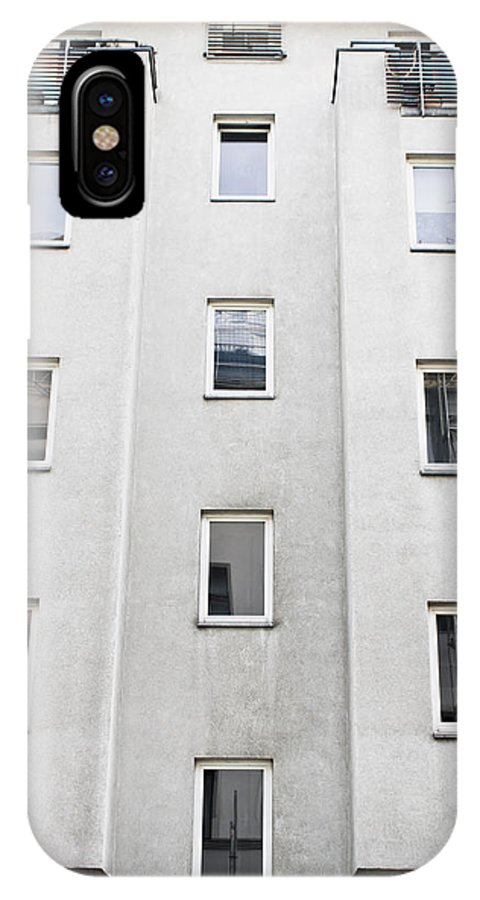 Apartment IPhone X / XS Case featuring the photograph Apartment Building by Tom Gowanlock