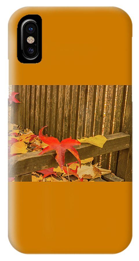 Autumn IPhone X Case featuring the photograph A Foliage Pillow On A Bench In A Woodland by Susanna Mattioda