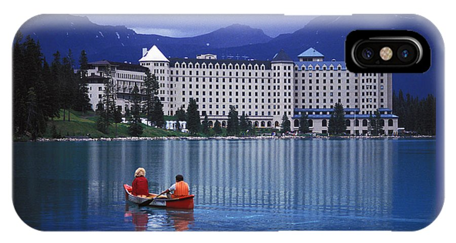 Couple IPhone X Case featuring the photograph Canoe On Lake Louise by Carl Purcell