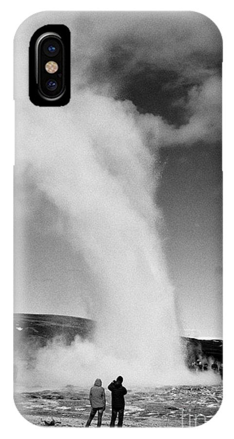 Geyser IPhone X / XS Case featuring the photograph tourists photograph strokkur geyser erupting at geyser geothermal site Geysir Iceland by Joe Fox