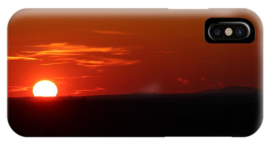 Sun Set IPhone X Case featuring the photograph Sunsets by Donn Ingemie
