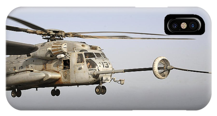 Horn Of Africa IPhone X Case featuring the photograph A U.s. Marine Corps Ch-53e Super by Stocktrek Images