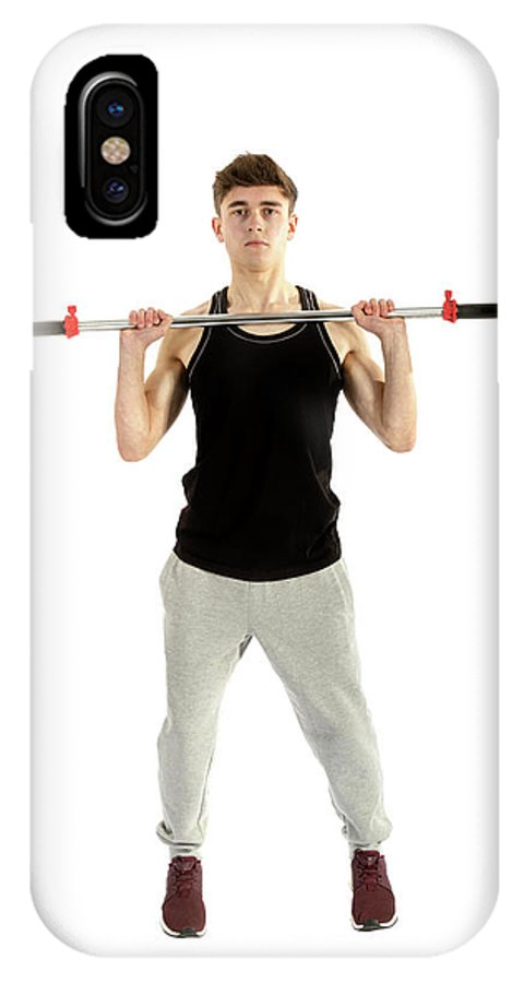 Adolescence IPhone X Case featuring the photograph 18 Year Old Teenage Boy Exercising With Weights by Ben Gingell
