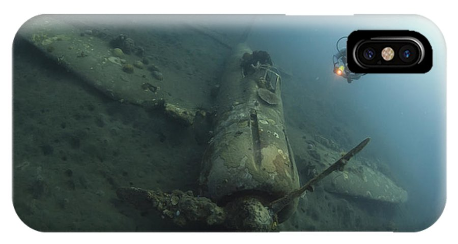 Kimbe Bay IPhone X Case featuring the photograph Diver Explores The Wreck by Steve Jones