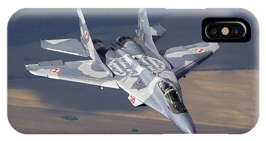 Horizontal IPhone X Case featuring the photograph A Polish Air Force Mig-29 Aircraft by Daniele Faccioli