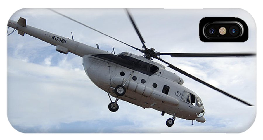 Air Force IPhone X Case featuring the photograph A U.s. Air Force Mi-8 Hip Helicopter by Stocktrek Images