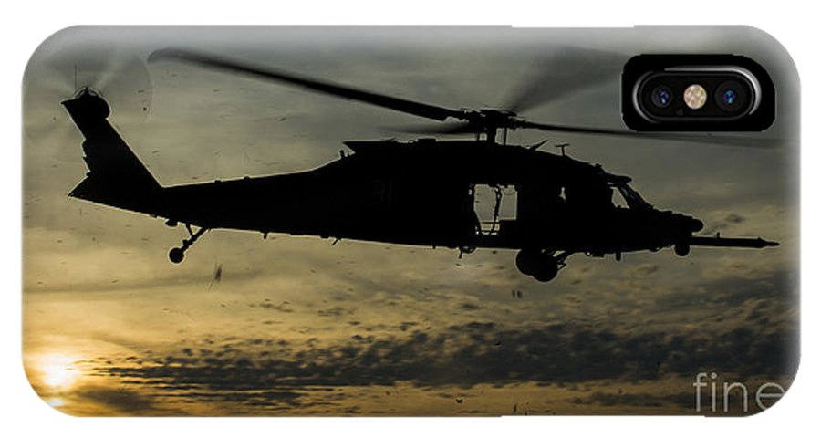 Exercise Emerald Warrior IPhone X Case featuring the photograph A U.s. Army Uh-60 Black Hawk Leaves by Stocktrek Images
