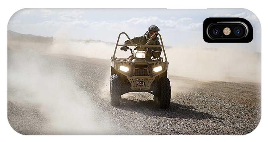 Soldier IPhone X Case featuring the photograph A U.s. Soldier Performs Off-road by Stocktrek Images