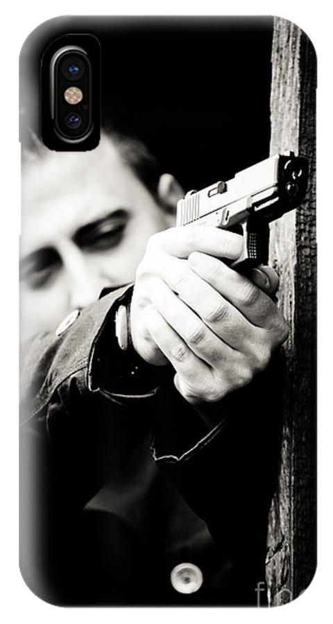 Man IPhone X / XS Case featuring the photograph Aim by Gabriela Insuratelu
