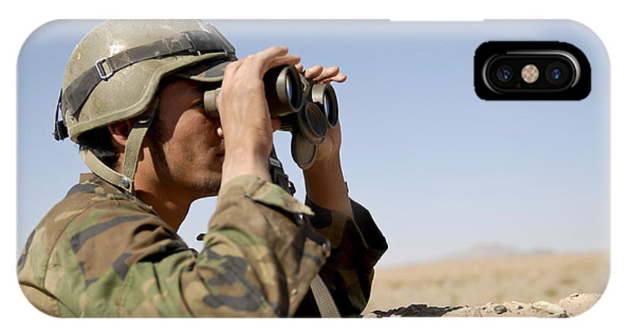 Afghanistan IPhone X Case featuring the photograph An Afghan Commando Scans The Horizon by Stocktrek Images