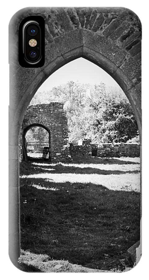 Irish IPhone X Case featuring the photograph Arched Door At Ballybeg Priory In Buttevant Ireland by Teresa Mucha