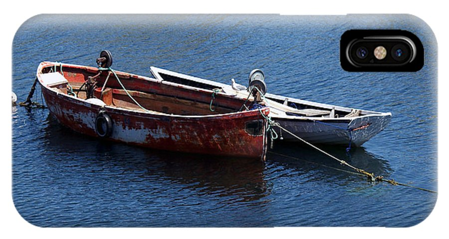 Boats IPhone X Case featuring the photograph At Rest by Kelvin Booker