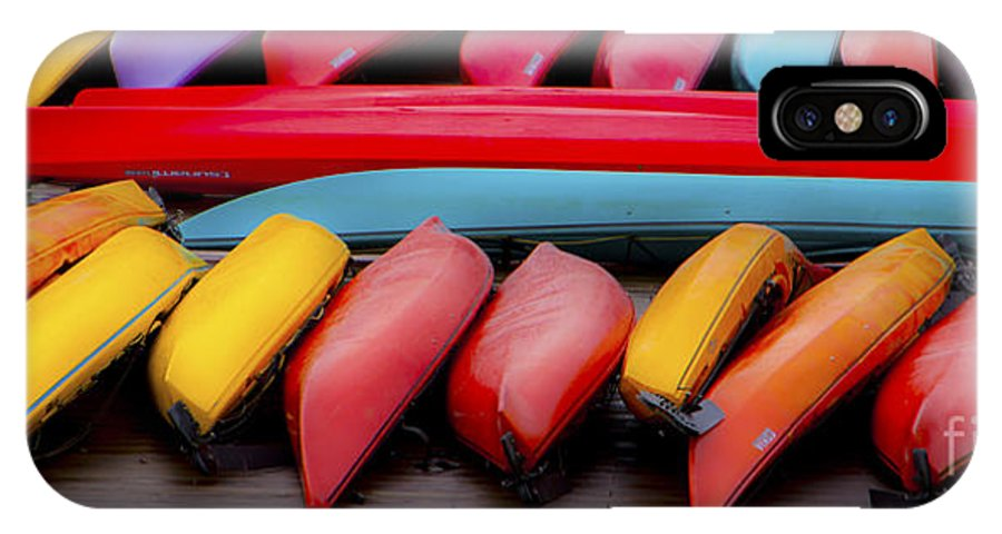 Kayaks IPhone X Case featuring the photograph At Rest by Larry Keahey