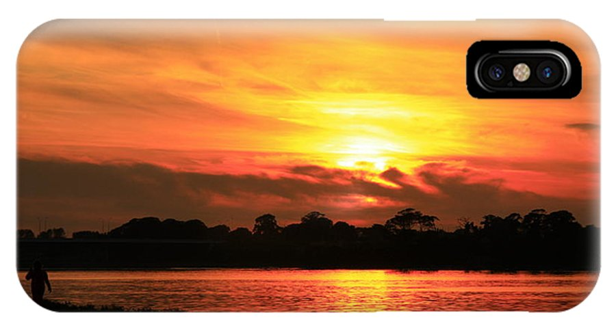 Sunsets IPhone X Case featuring the photograph At Sunset by Martina Fagan