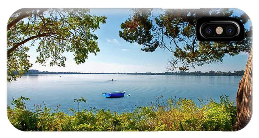 Boat IPhone X Case featuring the photograph Boat Framed By Trees And Foliage by David Arment