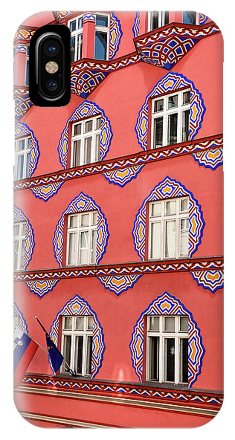 Cooperative Business Bank IPhone X Case featuring the photograph Brightly Colored Facade Of Cooperative Business Bank Building Or by Reimar Gaertner