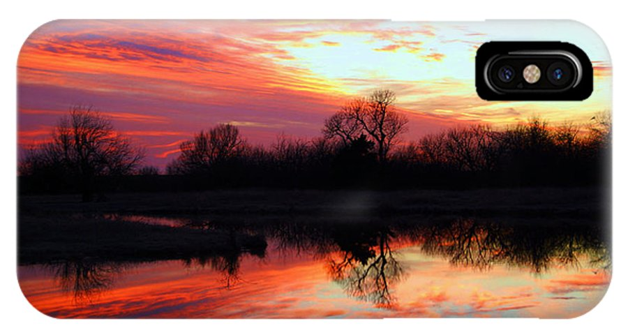 Clouds IPhone X Case featuring the photograph Calming Sunset by Larry Keahey