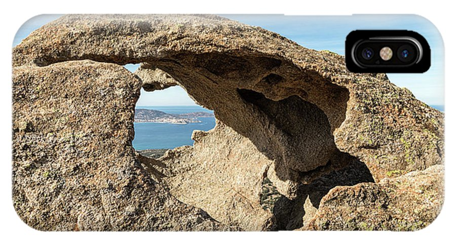 Balagne IPhone X Case featuring the photograph Calvi In Corsica Viewed Through A Hole In A Rock by Jon Ingall