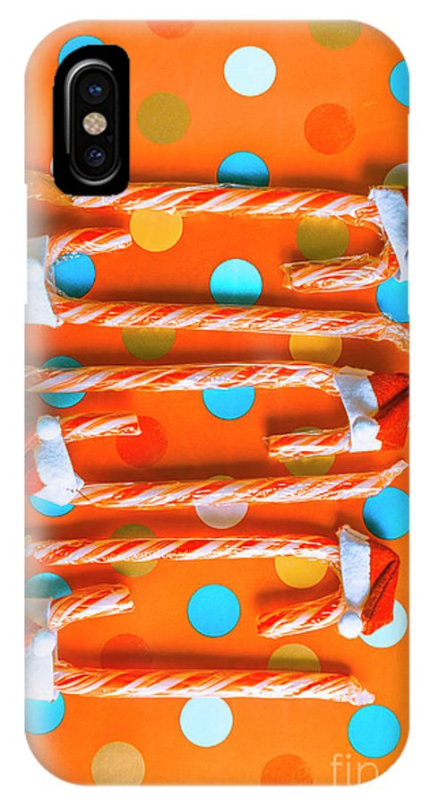 Holiday IPhone X Case featuring the photograph Candy Canes And Christmas Hats by Jorgo Photography - Wall Art Gallery