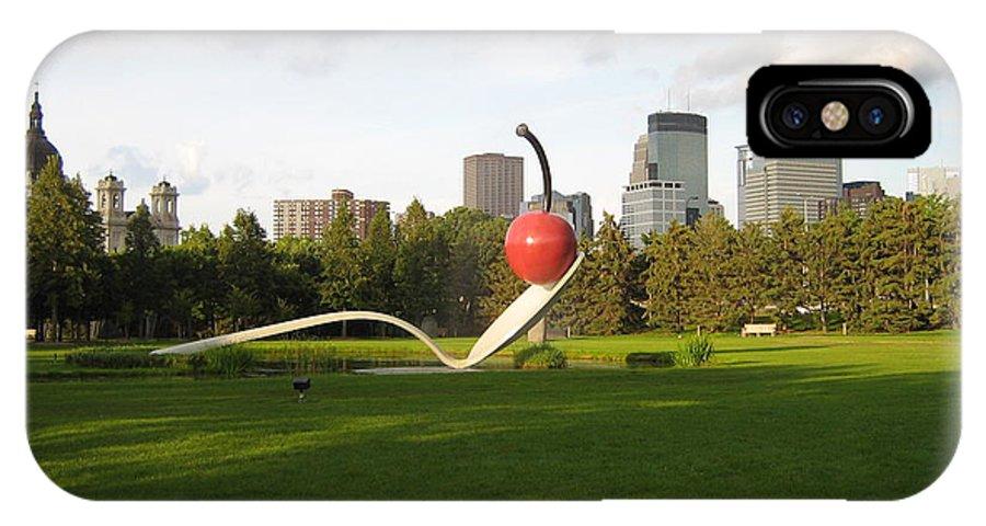 Cherry Bridge Sculpture IPhone X Case featuring the photograph Cherry Bridge Sculpture by D Nigon
