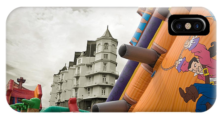 Childrens IPhone X Case featuring the photograph Childrens Play Areas Contrast With The Victorian Elegance Of The Grand Hotel In Llandudno Wales Uk by Mal Bray