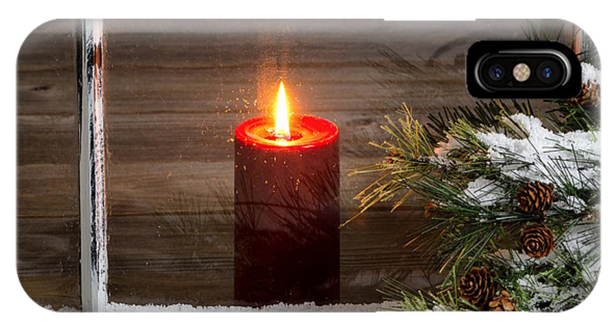 Christmas IPhone X Case featuring the photograph Christmas Red Candle With Snow Covered Home Window And Pine Tree by Thomas Baker