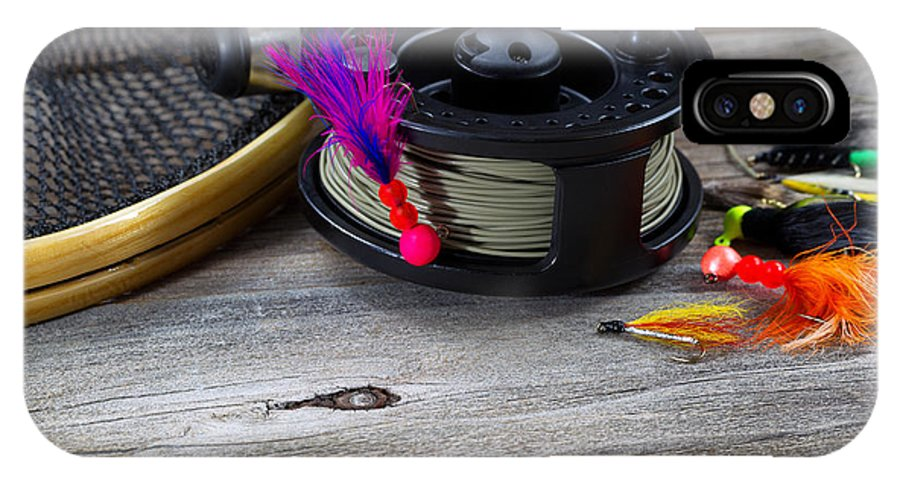 Fishing IPhone X Case featuring the photograph Close Up Of Fly Reel With Fly Jig Hanging From Spool by Thomas Baker