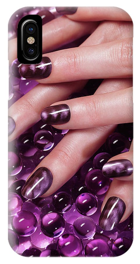 Manicure IPhone X Case featuring the photograph Closeup Of Woman Hands With Purple Nail Polish by Maxim Images Prints