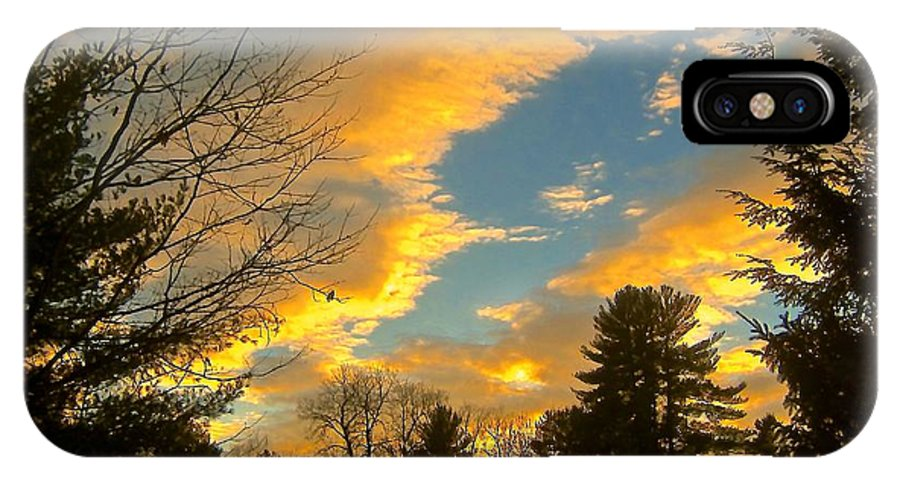 IPhone X / XS Case featuring the photograph Clouds Catching The Evening Light by Elizabeth Tillar