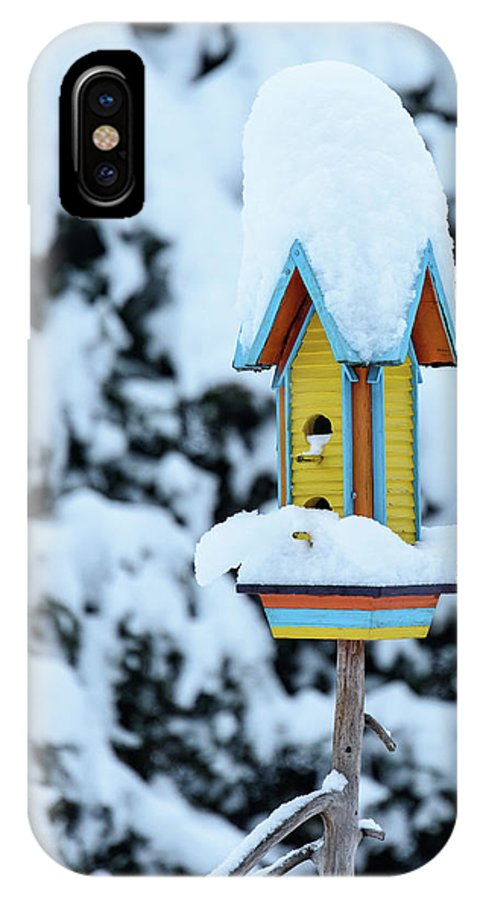 Winter IPhone X Case featuring the photograph Colorful Wooden Birdhouse In The Snow by Nicola Simeoni