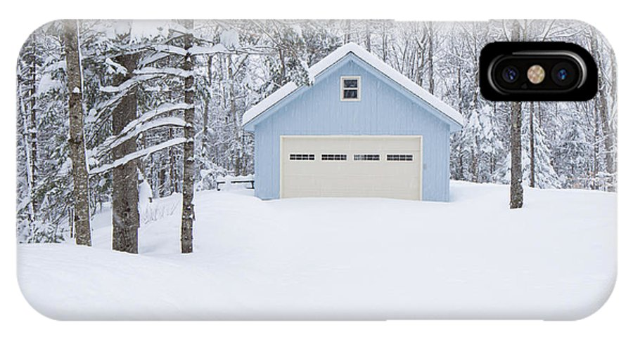 Blue IPhone X Case featuring the photograph Cute Blue And Ivory Garage In The Snow by Edward Fielding