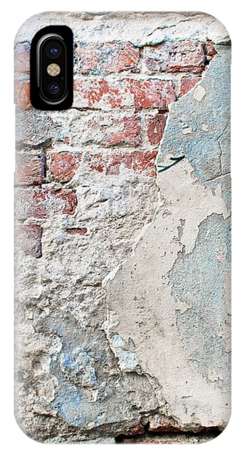 Abandoned IPhone X / XS Case featuring the photograph Damaged Brick Wall by Tom Gowanlock