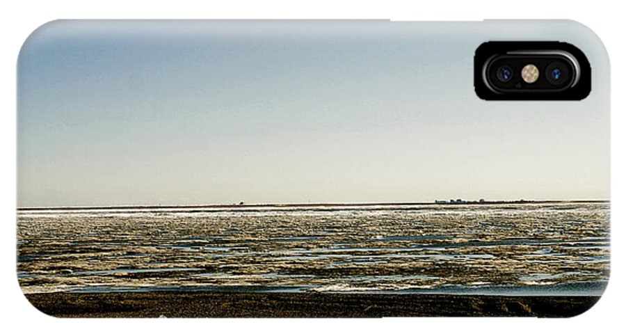 Driftwood IPhone X Case featuring the photograph Driftwood On Arctic Beach by Anthony Jones