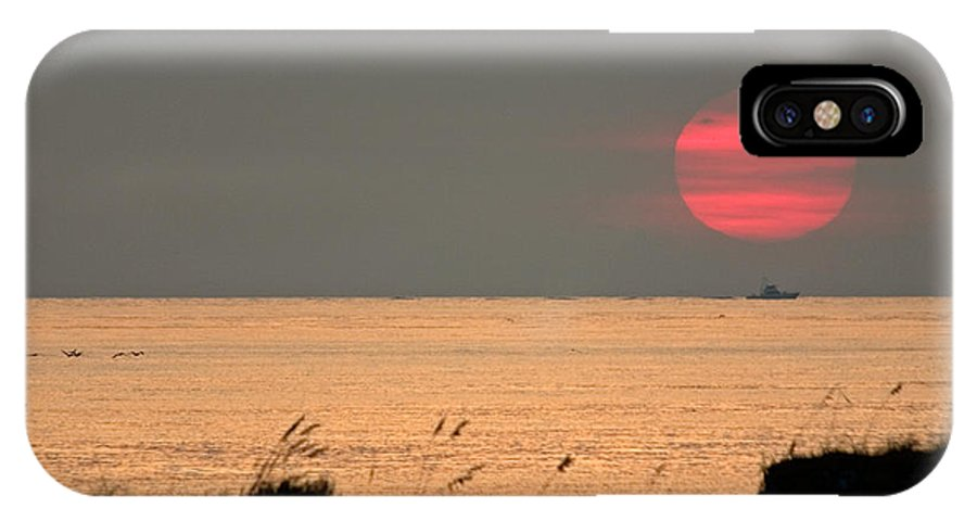 Sun Set IPhone X / XS Case featuring the photograph Fishing Boat Under Setting Sun by John Harmon