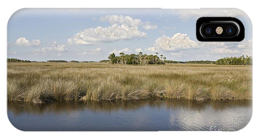 Florida Landscape; Classic Landscape; Salt Marsh; Tidal Marsh; Marsh Grass; Brackish Water; Blue Sky; Clouds; Fluffy Clouds; Red Cedar Trees; Southern Red Cedar; Cabbage Palm; State Tree; Pencil; Gulf Coast; Gulf Of Mexico; Florida Gulf Coast; Florida Coast; Juniperus Silicicola; Juniperus Virginiana; Sabal Palmetto; Black Needle Rush; Juncus Roemerianus; Saltmeadow Cord Grass; Spartina Patens; Smooth Cord Grass; Spartina Alterniflora IPhone X Case featuring the photograph Florida Salt Marsh by John Arnaldi