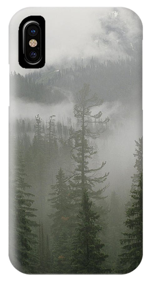North America IPhone X / XS Case featuring the photograph Fog Hangs In A Valley Of Evergreens by Raymond Gehman