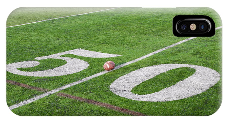 Football IPhone X Case featuring the photograph Football On The 50 Yard Line by Bill Cannon