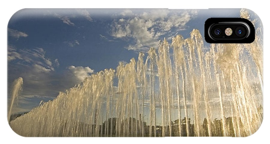 Fountain IPhone X / XS Case featuring the photograph Fountain With Sunlight From The Side by Sven Brogren