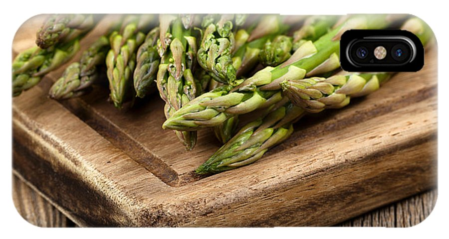 Asparagus IPhone X Case featuring the photograph Fresh Asparagus On Rustic Wooden Server Board by Thomas Baker