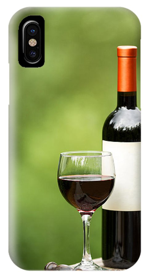 Wine IPhone X Case featuring the photograph Glass Of Red Wine Outdoors Ready To Enjoy by Thomas Baker
