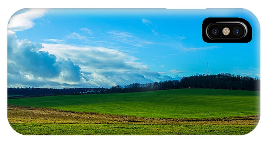 Sky IPhone X Case featuring the photograph Green Grass And Blue Sky With White Clouds by Valery Rudnev
