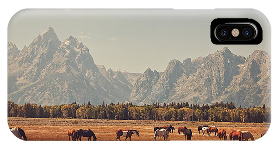 Teton's IPhone X Case featuring the photograph Horses Grazing In Front Of The Teton's by Carolyn Rauh