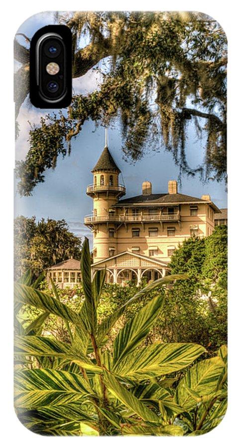 Jekyll IPhone X Case featuring the photograph Jekyll Island Club Hotel Through the Foliage by Douglas Barnett